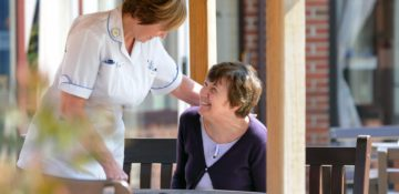 Nurse talking to a patient during Nurses Month